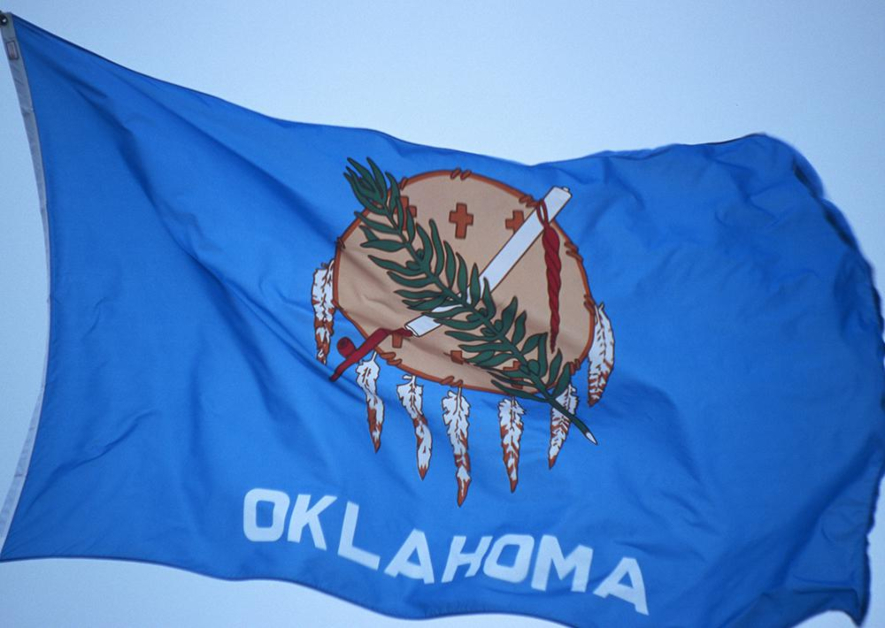 Oklahoma State Flag Blue Backdrop with Dream Catcher Crosses and Green Branch